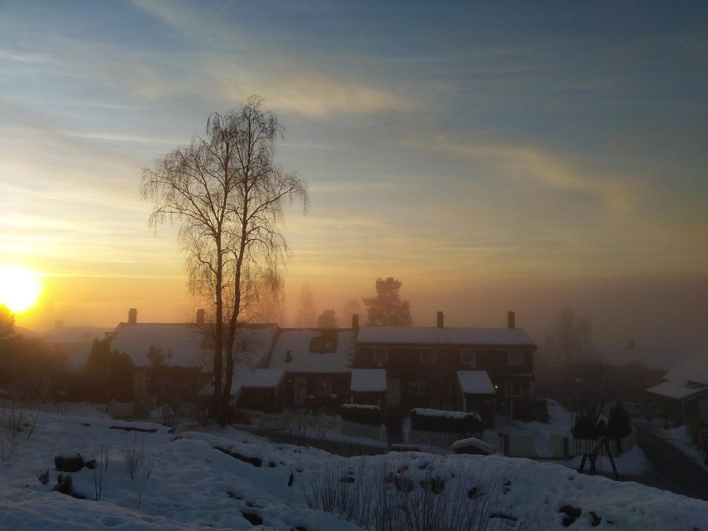 Utsyn fra Alverntoppen vinterstid i solnedgang.